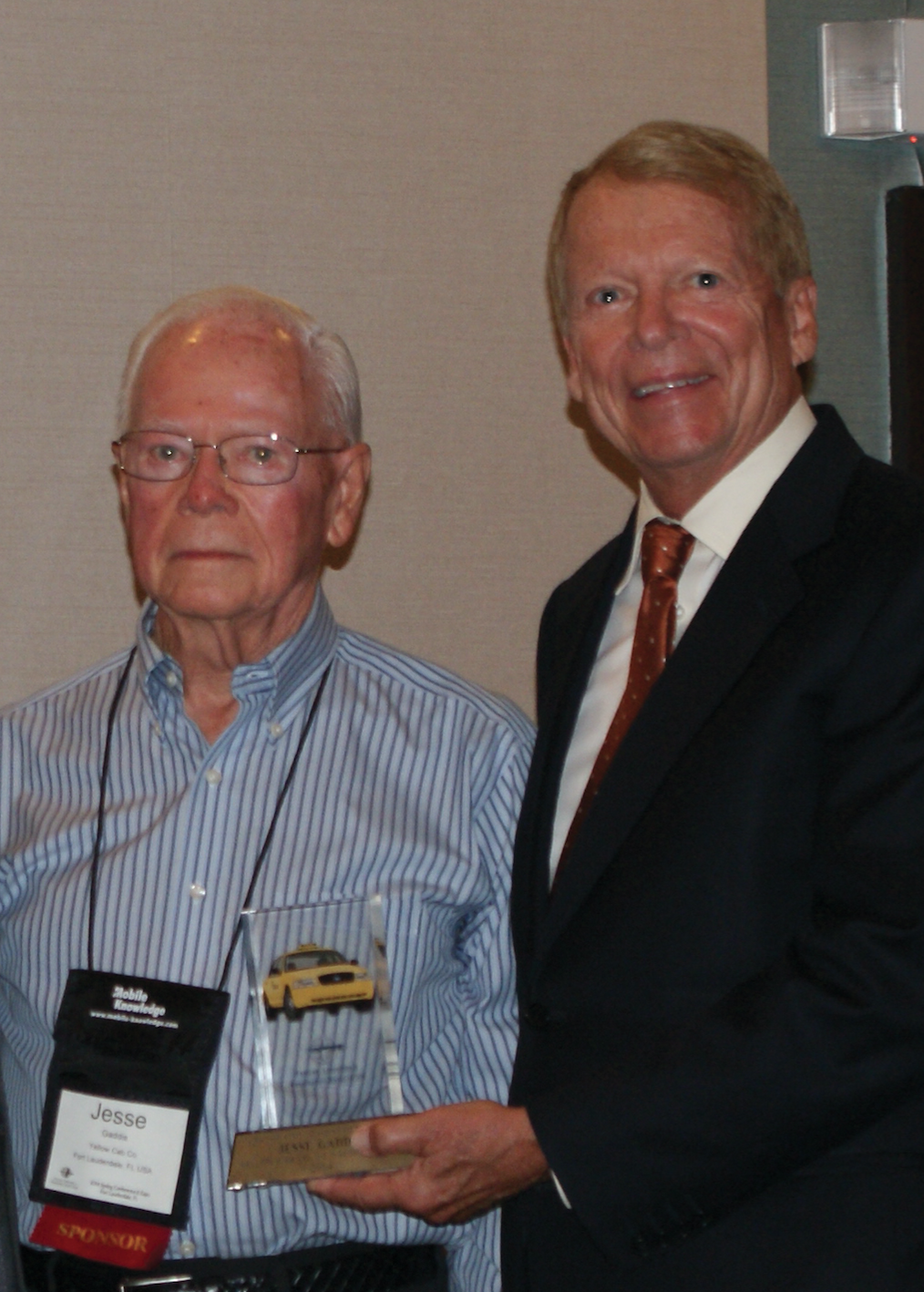Jesse Gaddis (left) receives TLPA's most prestigious award for his lifetime leadership and contributions to the transportation  industry and the TLPA.